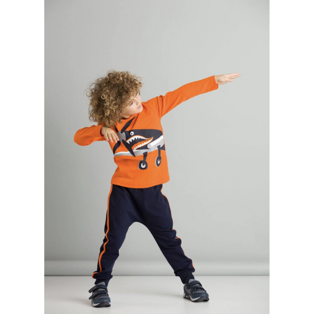 2 piece set  Tshirt with a print on and matching pants with orange bants on  sides